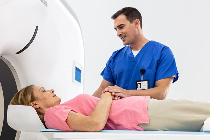 The Philips Incisive CT with patient and technician.